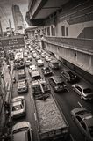 Sathorn street and MRT station. Sathorn street in Bangkok, jammed with traffic at a red light Stock Image
