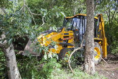 Sathyamangalam, Tamil Nadu, India - June 24, 2015: An excavator is seen parked among trees in the Sathyamangalam forest Royalty Free Stock Photography