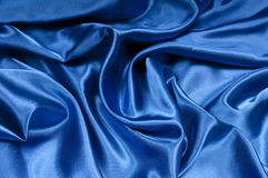 Satin in Blue Series. Closeup view of blue satin perfect for abstract background. Part of a series Royalty Free Stock Photo