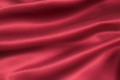 Satin Cerise diff. A folded and flowing background of Deep, rich, cherry coloured satin stock image