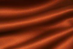 Satin Chocoloate 1 dif. A deep, rich, chocolate coloured satin creates a folded and flowing background royalty free stock photography