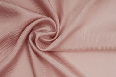 Satin cream-coloured fabric Stock Photo