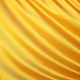 Satin d'or, ondes de soie Fond jaune Image stock