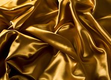 Satin de luxe d'or Images libres de droits