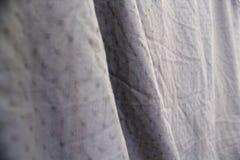 Satin drapery. Noble pleats natural fabrics. royalty free stock image