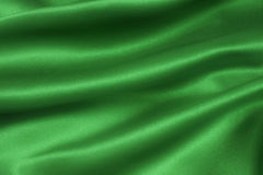 Satin Emerald dif. A folded and flowing background of Deep, rich, emerald coloured satin stock photos
