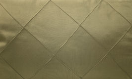 Satin fabric adorned with decorative stitching background Stock Photography