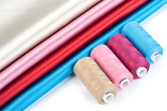 Satin fabric and tailor's accessories Stock Image