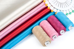 Satin fabric and tailor's accessories Stock Photography