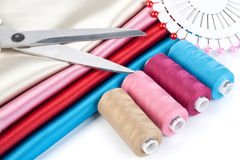 Satin fabric and tailor's accessories Royalty Free Stock Image