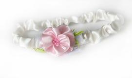 Satin headband with flowers. White satin headband with pink flowers Stock Photos