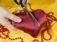 Satin heart cut with scissors. Broken heart. Divorce concept. Couple separation. Stock Images