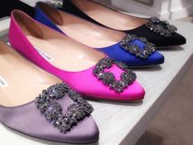Satin and jewel-embellished women shoes Stock Photography