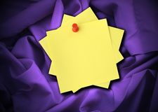 Satin and notes. Close-up of purple satin and blank adhesive notes Royalty Free Stock Photography