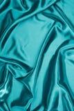 satin onduleux brillant de turquoise photos libres de droits