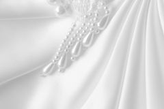 Satin and pearls. White Satin and pearls for abstract background Royalty Free Stock Image