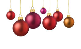 Satin red christmas balls. Red matte christmas decoration balls hanging on white background stock photography