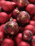 Satin red christmas balls. Lots of red matte christmas decoration balls royalty free stock photos