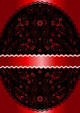 Satin red ribbon in red wavy openwork floral oval frame. On satin red background Royalty Free Stock Photos