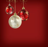 Satin red and white christmas balls. White and red matte christmas decoration balls hanging on vivid red background stock photography