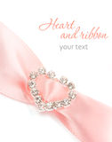 Satin ribbon with heart. Pink wedding satin ribbon with shining heart on a white background Royalty Free Stock Image
