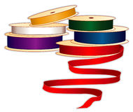 Satin Ribbon in Jewel Tones. Spools of satin ribbons in jewel colors for sewing, tailoring, quilting, crafts, needlework & do it yourself projects Royalty Free Stock Photo