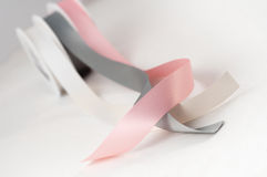 Satin ribbon reels isolated pink gray silver gift Stock Photos