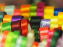 Satin ribbon a substrate background of rainbow colors royalty free stock photo