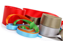 Satin ribbons of different colors. Some satin ribbons of different colors on a white background royalty free stock images