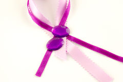 Satin ribbons and polished gems Royalty Free Stock Photography