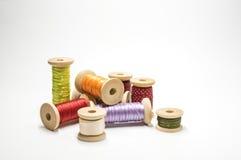 Satin ribbons on spools Stock Photo