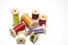 Satin ribbons on spools Royalty Free Stock Photo