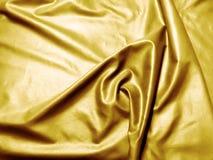Satin sheet gold Stock Image