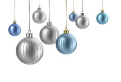 Satin silver and blue christmas balls. Silver and blue matte christmas decoration balls hanging on white background royalty free stock photography