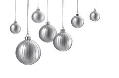 Satin silver christmas balls. Silver matte christmas decoration balls hanging on white background stock image