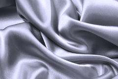 Satin wave. Silver background Stock Image