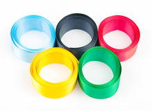 Satiny tapes combined in form of Olympic rings Stock Photos