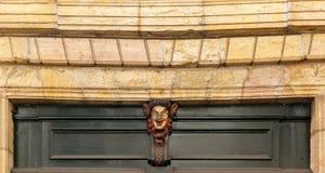 Satire mask over the house door. Burgundy, France Stock Photos