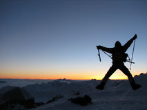 Satisfaction. Happy climber on a roof of the world Stock Photography