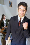 Satisfaction. Man walking out of a meeting with a female colleague pumping his fist Royalty Free Stock Image
