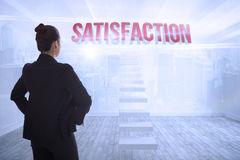 Satisfaction against city scene in a room Stock Images