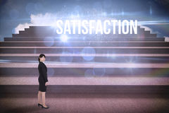 Satisfaction against steps against blue sky Royalty Free Stock Photography