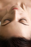 Satisfaction (beauty salon series). Relaxing at beauty salon. feeling of satisfaction on beautiful face. selective focus at the eyes closed and nose Stock Image