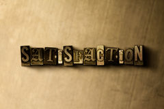 SATISFACTION - close-up of grungy vintage typeset word on metal backdrop Stock Photos