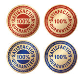 Satisfaction guaranteed gold badge Royalty Free Stock Photos