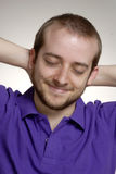 Satisfaction man. Expressive and happy young man portrait.Young man touching his neck Stock Photos