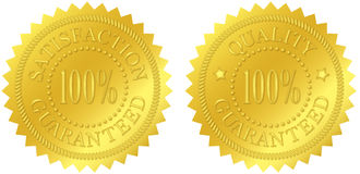 Satisfaction and Quality Guaranteed Gold Seals. With embossed decorations Royalty Free Stock Photo