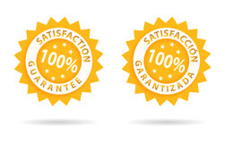 Satisfaction-satisfaccion. Satisfaction guarantee 100%, in english or spanish Royalty Free Stock Photo