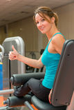 The satisfaction of the training girl. In the gym Royalty Free Stock Image