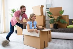 Satisfaction of the young couple at new home. Satisfaction of the young couple after buying a new home Stock Images